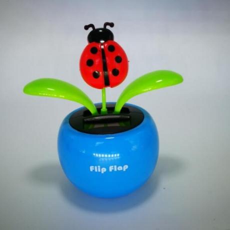 Solar flip flap automatic swing ladybug