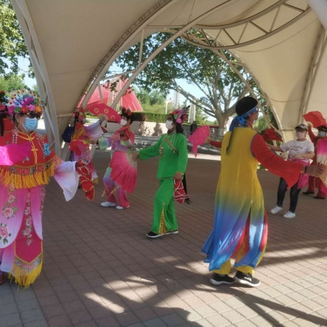 Chinese outdoor masquerade dance against the background of new coronavirus
