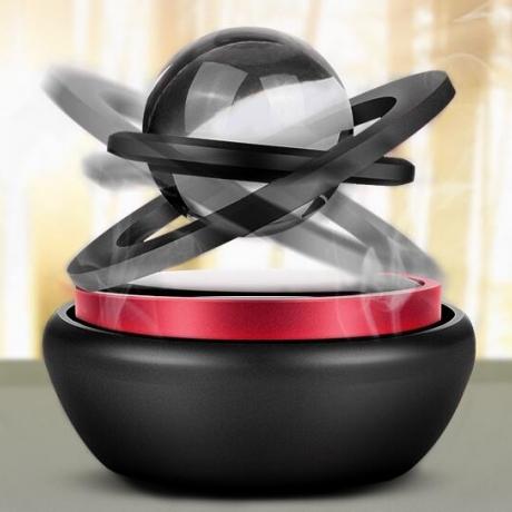 Solar powered rotary ball car perfume decoration
